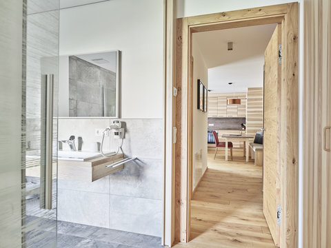 Interior of open plan kitchen and bathroom of a holiday home