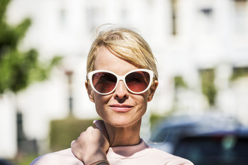 Portrait of blond woman wearing sunglasses