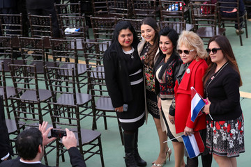 People pose for a picture at the Lopez Palace before Paraguay's new President Mario Abdo Benitez's swearing-in ceremony in Asuncion,