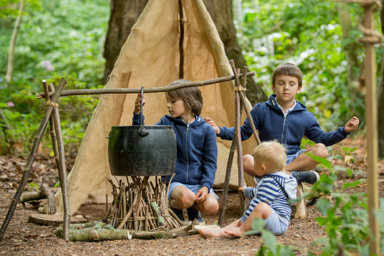Beautiful children, siblings, camping in the forest