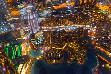 Dubai downtown night scene with city lights.