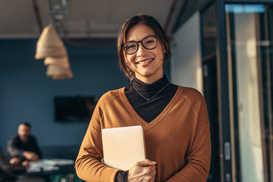 Smiling woman in casuals in office
