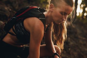 Sportswoman resting after a trail run