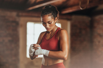 Female boxer wearing strap on wrist