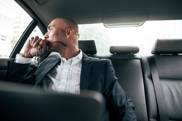 Businessman travelling to office in car