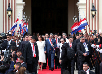 Paraguay's new President Mario Abdo Benitez and first lady Silvana Lopez Moreira leave the Metropolitan Cathedral after the 'Te Deum' in Asuncion