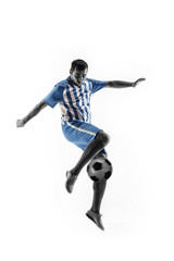 Professional football soccer player with ball isolated on white studio background