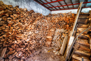 Stacked firewood in woodshed ready for winter