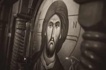 Ancient Orthodox icon showing Jesus Christ. Sepia filter.