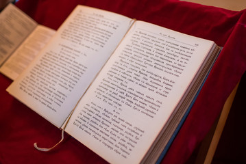 Opened Bible in a Serbian orthodox church. Cyrillic Bible.