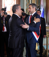 Paraguay's new President Abdo Benitez greets Colombia's President Duque after the swearing-in ceremony at the Lopez Palace in Asuncion