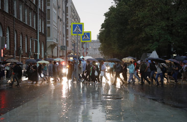 People march during a rally on behalf of the defendants in the Novoye Velichye case in central Moscow