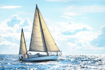 Vintage wooden two mast yacht (yawl) sailing in a open sea on a clear day