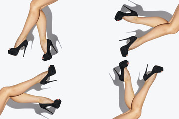 Sexy Woman legs with black shoes isolated on white