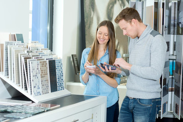 young couple choosing tiles