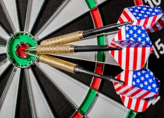 Closeup of a Darts with American Flag in Bullseye