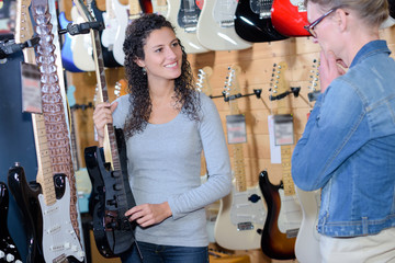 Two women in musical instrument store