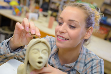 Female sculptor at work