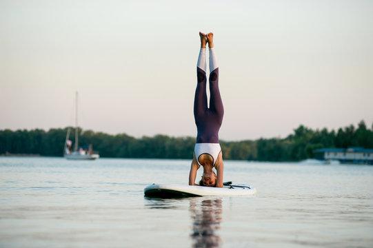 SUP young beautiful girl yoga meditation