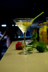 Red Rose and Martini Cocktail with Olives with  the Background of  Billiard Table