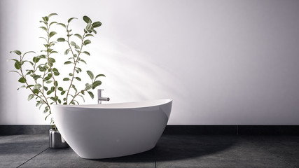 Tub standing close to plant in metal pot