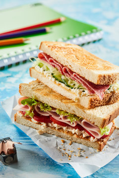 Toasted ham and pastrami sandwiches