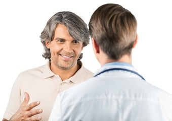 Portrait of a Mature Man Talking with a Doctor