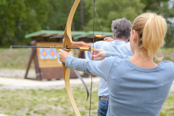 Couple during archery practice