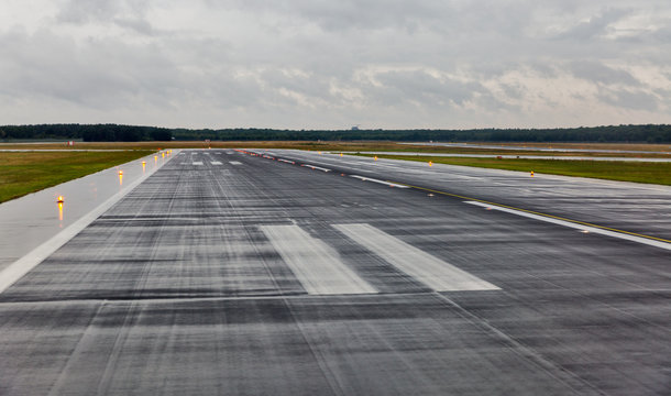 empty runway at the passenger airport in the rain