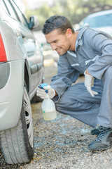 Mechanic cleaning a hubcap