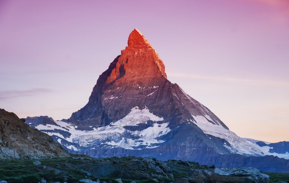 Matterhorn peak during sunrise. Beautiful natural landscape in the Switzerland. Mountains landscape at the summer time