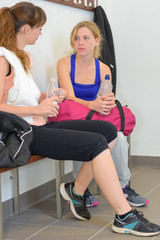 Sports women talking in changing room