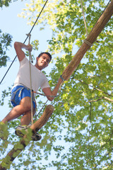 man on a rope climbing in the adventure park