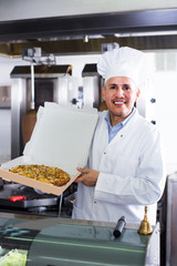 man chef holding pizza