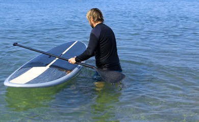 Portrait of a Man with Surfboard on Water