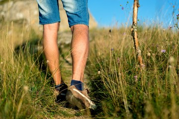 Closeup of Man's Legs Walking Through the Field
