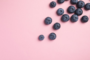Flat lay composition with tasty blueberry and space for text on color background