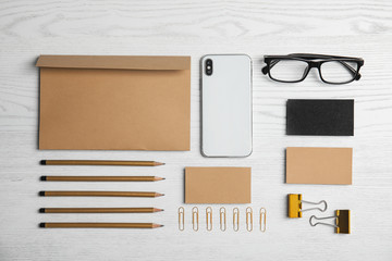 Flat lay composition with stationery on white wooden background. Mock up for design