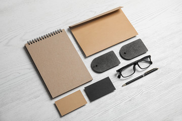 Composition with stationery on white wooden background. Mock up for design