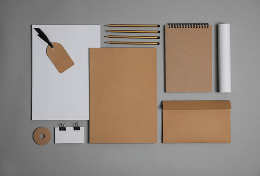 Flat lay composition with stationery on grey background. Mock up for design