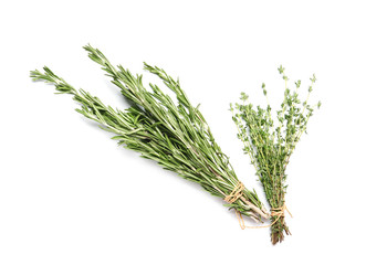 Rosemary and thyme on white background, top view. Aromatic herbs