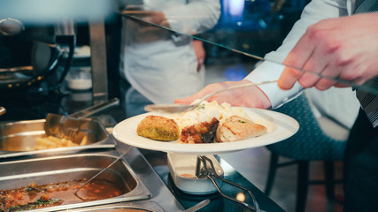 buffet: people take food in plates.