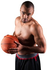 Portrait of young handsome sporty man with ball isolated on