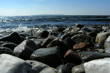 The river bank with a large pebble.