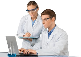 Scientists and Researcher Working with Laptop