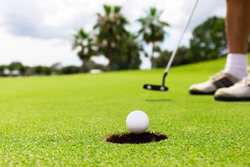 close up of putting a golf ball