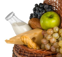 Cheeses, Apple, Grapes, Roll and Milk in the Picnic Basket -