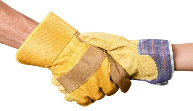 Closeup of Two People with Safety Gloves Shaking Hands