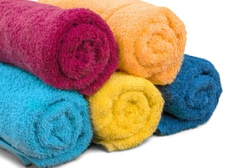 Rolled fluffy towels isolated on white background