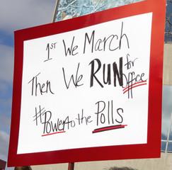 First We March, Then We Run For Office, Says Sign Held By Women